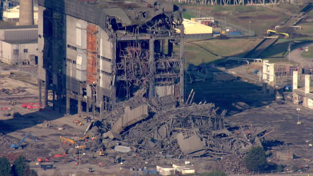 shows aerial shots zoom into and across huge pile of debris and wreckage from collapsed building at didcot power station rescuers say they believe... - didcot stock videos and b-roll footage