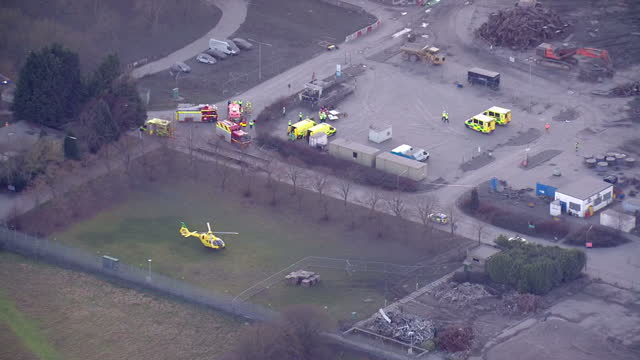 shows aerial shots zoom into emergency services vehicles including air ambulance with pan to collapsed building at didcot power station one person... - didcot stock videos and b-roll footage