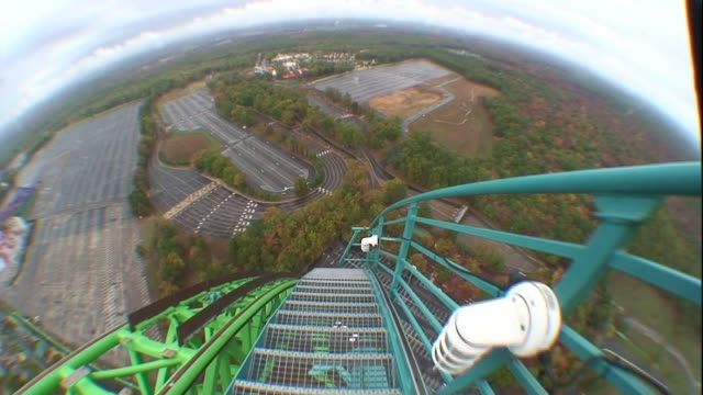 a pov shows an amusement park from the top of a giant roller coaster. - roller coaster stock videos & royalty-free footage