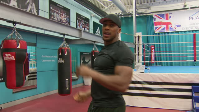 Shows British professional boxer Anthony Joshua arriving for interview with Sky News' Jacquie Beltrao at English Institute of Sport Sheffield on...