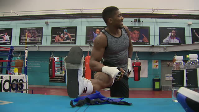 Shows British professional boxer Anthony Joshua stretching during training session at English Institute of Sport Sheffield on October 6th 2017