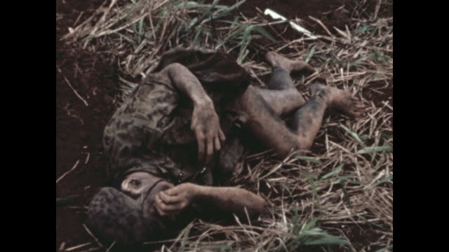 shows dead north vietnamese commandos near american bunkers they attacked michael fitzmaurice was awarded the medal of honor for actions in that... - ベトコン点の映像素材/bロール
