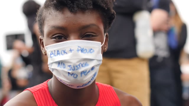 shows exterior and aerial shots black lives matter protesters marching and gathered in central london chanting shouting holding signs exterior shots... - i can't breathe stock videos & royalty-free footage