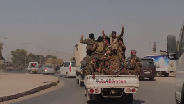 shows exterior driving point of view shots lightly armed kurdish militia heading towards front lines in turkey offensive, and quiet roads in area... - クルド人点の映像素材/bロール