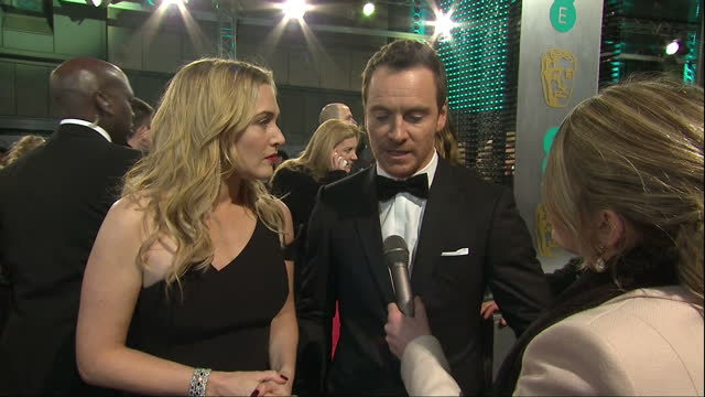 shows exterior interview with actress kate winslet and actor michael fassbender on on diversity in roles in film industry the 2016 baftas film awards... - kate winslet stock videos and b-roll footage