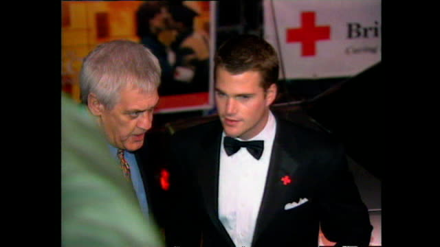 shows exterior night shots actor chris o'donnell arriving at the premiere for the film 'in love and war' in leicester square on february 12, 1997 in... - film premiere stock videos & royalty-free footage