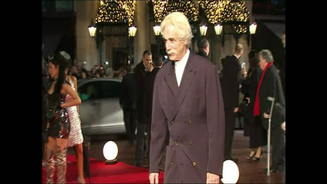 shows exterior night shots actor sam elliott posing for photographers on the red carpet in leicester square for 'did you hear about the morgans?' uk... - sam elliott stock videos & royalty-free footage