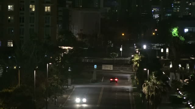shows exterior night shots cars being blown around driving along abandoned street as trees blow around as hurricane maria approaches puerto rico on... - puerto rico stock videos & royalty-free footage