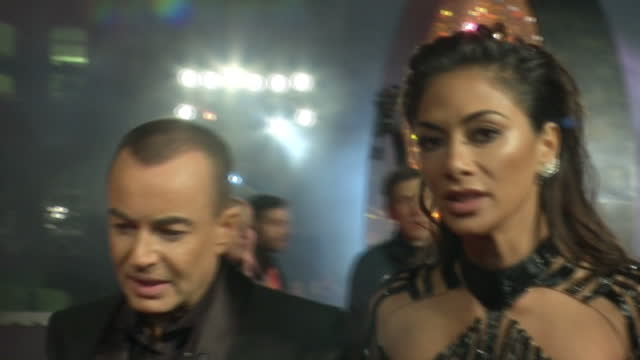 shows exterior night shots julien macdonald welsh fashion designer and nicole scherzinger american singer on red carpet and interview with them the... - nicole scherzinger stock videos and b-roll footage