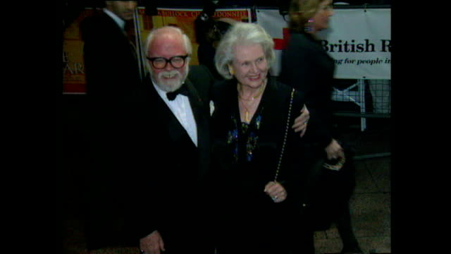 shows exterior night shots lord richard attenborough arriving at the premiere for the film 'in love and war' in leicester square on february 12, 1997... - film premiere stock videos & royalty-free footage