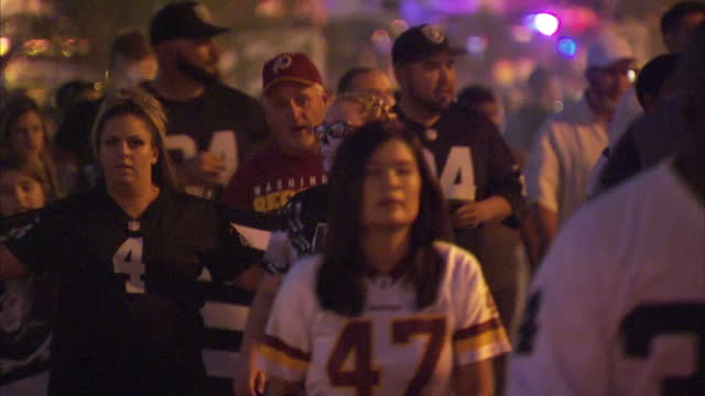 Shows exterior night shots NFL Redskins and Raiders fans departing Fedex Field stadium after match on 25th September 2017 in Washington DC USA