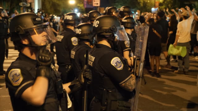 shows exterior night shots protesters gathered on the streets of washington dc facing off with riot police and close ups of riot police protective... - george floyd stock videos & royalty-free footage