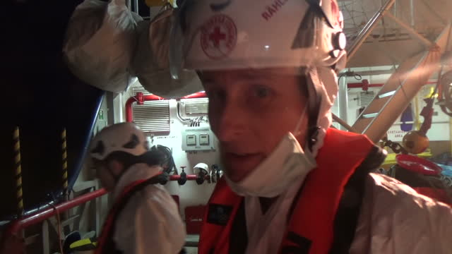 Shows exterior night shots soundbite with Migrant Offshore Aid Station worker speaking on possibility of severe medical conditions amongst rescued...