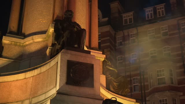shows exterior night shots statues on outside of the royal albert hall lit for the fashion awards ceremony the fashion awards in partnership with... - royal albert hall stock videos & royalty-free footage