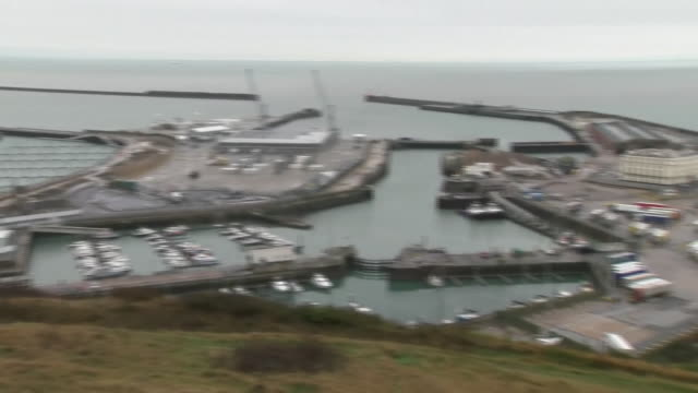 shows exterior shot pan across dover seafront from port to harbour. a total of 69 migrants have been brought ashore in dover today, after trying to... - port said stock videos & royalty-free footage