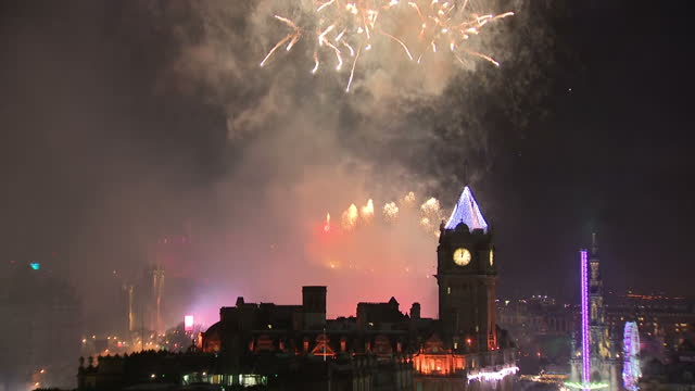Shows exterior shot rooftops of Edinburgh looking towards Edinburgh Castle as fireworks are let off to celebrate start of 2018 Celebrations to see in...