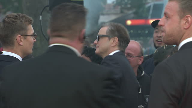 shows exterior shots actor colin firth signing autographs, posing for selfies and talking to press on the orange carpet at the world premiere of... - fame stock videos & royalty-free footage