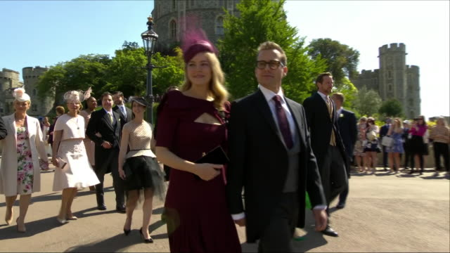 Shows exterior shots Actor Gabriel Macht and wife Jacinda Barrett arriving at St George's Chapel for the wedding of Prince Harry Duke of Sussex and...