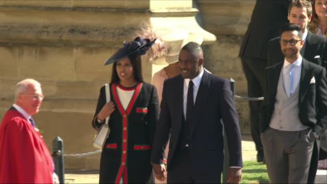 shows exterior shots actor idris elba with actress sabrina dhowrem followed by oprah winfrey arriving at st george's chapel for the wedding of prince... - oprah winfrey stock videos & royalty-free footage