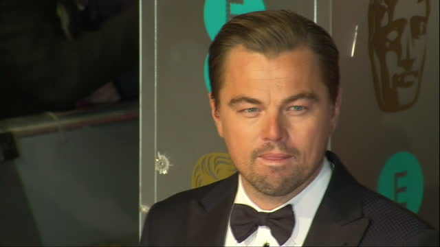 Shows Exterior shots actor Leonardo DiCaprio and director Alejandro Gonzalez Inarritu posing for photos on red carpet The 2016 BAFTAS Film Awards...