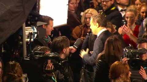 shows exterior shots actor leonardo dicaprio arriving, signing autographs and talking to press on red carpet. the 2016 baftas film awards ceremony is... - 親筆簽名 個影片檔及 b 捲影像