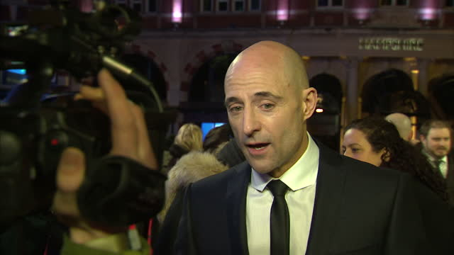 shows exterior shots actor mark strong talking to press on red carpet with pan to sacha baron cohen in character as 'nobby' sacha baron cohen has... - borat stock-videos und b-roll-filmmaterial