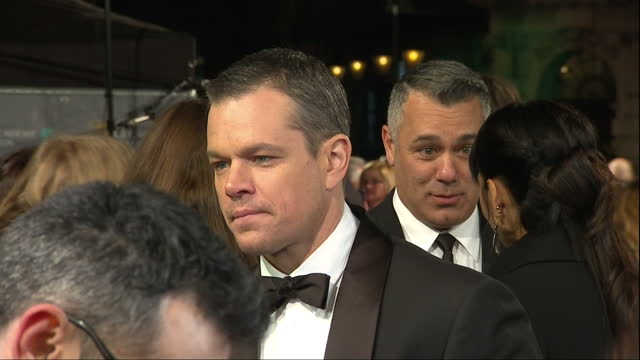 shows exterior shots actor matt damon being interviewed on the red carpet the 2016 baftas film awards ceremony at was held at london's royal opera... - matt damon stock videos and b-roll footage