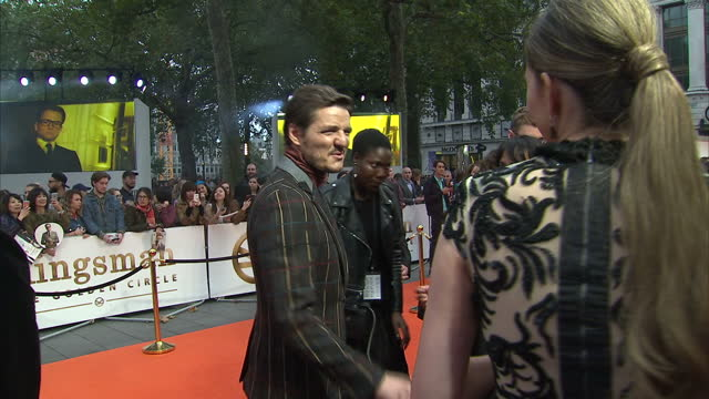 clean shows exterior shots actor pedro pascal talking to press and fans and posing fro selfies on the orange carpet at the world premiere of... - pedro pascal stock videos & royalty-free footage