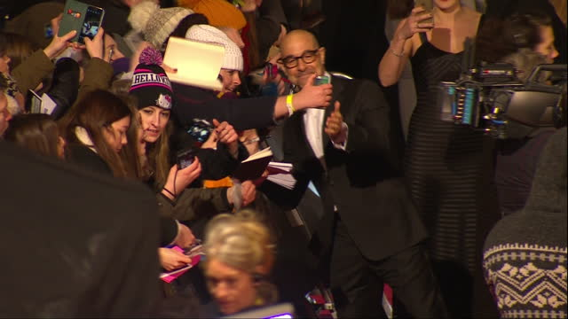 Shows Exterior shots actor Stanley Tucci signing autographs on red carpet The 2016 BAFTAS Film Awards ceremony at was held at London's Royal Opera...