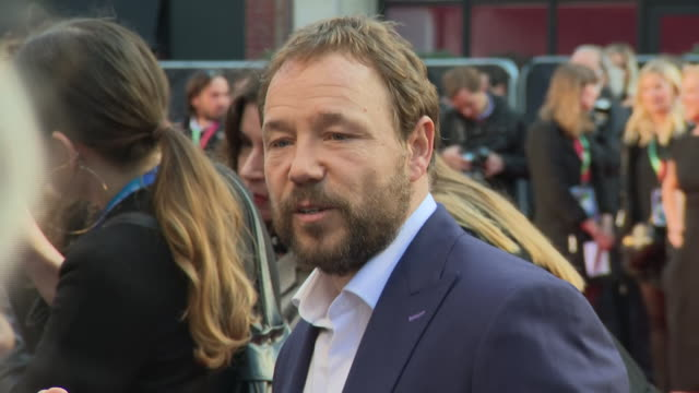 shows exterior shots actor stephen graham on the red carpet for the bfi's london film festival closing night gala premiere of martin scorsese's filme... - premiere stock-videos und b-roll-filmmaterial