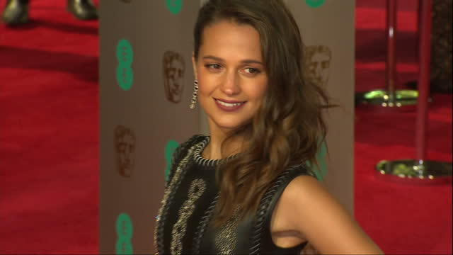 Shows Exterior shots actress Alicia Vikander posing for photos on red carpetThe 2016 BAFTAS Film Awards ceremony at was held at London's Royal Opera...