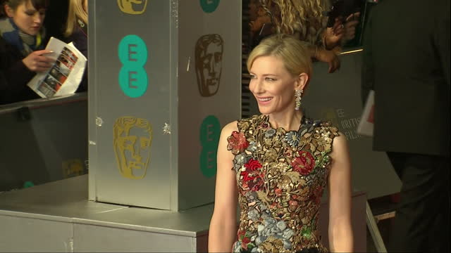 shows exterior shots actress cate blanchett walking down red carpet and posing for photos. the 2016 baftas film awards ceremony at was held at... - ケイト・ブランシェット点の映像素材/bロール