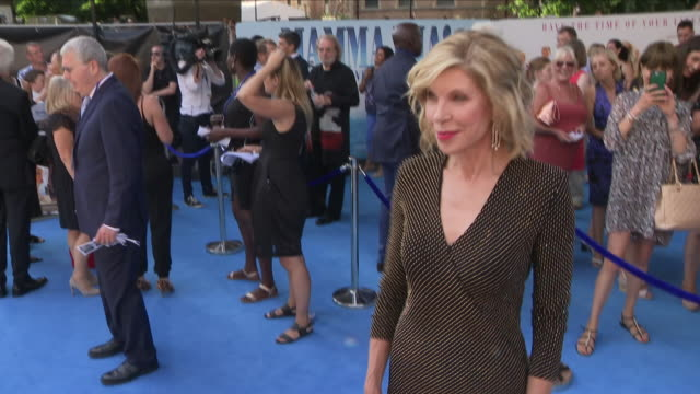 Shows exterior shots actress Christine Baranski talking to press at the 'blue' carpet British Premiere of the film sequel Mamma Mia Here We Go Again...