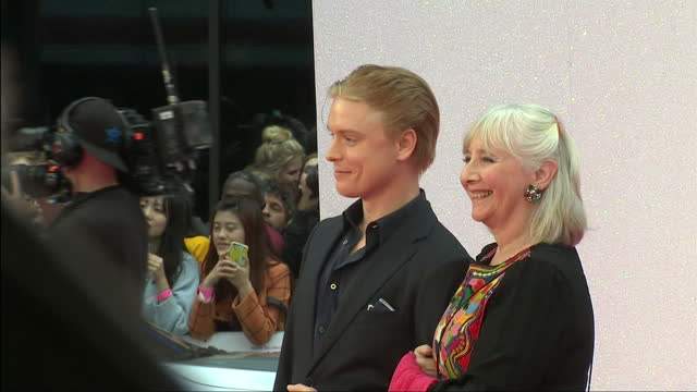 Shows exterior shots actress Gemma Jones and actor Freddie Fox posing for photos on pink carpet of premiere for Bridget Jones Baby on September 05...