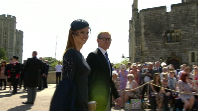 Shows exterior shots actress Sarah Rafferty and husband Santtu Seppala arriving at St George's Chapel for the wedding of Prince Harry Duke of Sussex...