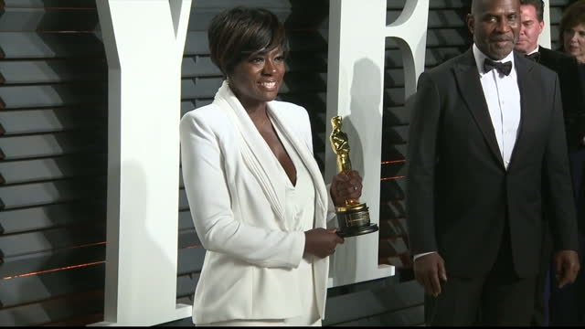 shows exterior shots actress viola davis arriving at the vanity fair postoscars party and posing for photographers holding her oscar statuette for... - vanity fair oscar party stock videos & royalty-free footage