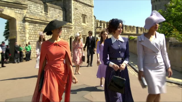 Shows exterior shots actresses Abigail Spencer and Priyanka Chopra arriving at St George's Chapel for the wedding of Prince Harry Duke of Sussex and...