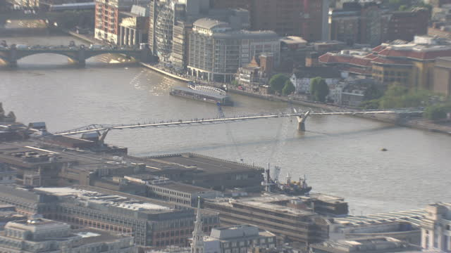 shows exterior shots aerials people walking along the millennium bridge on july 08 2015 in london england - チャンセラー点の映像素材/bロール