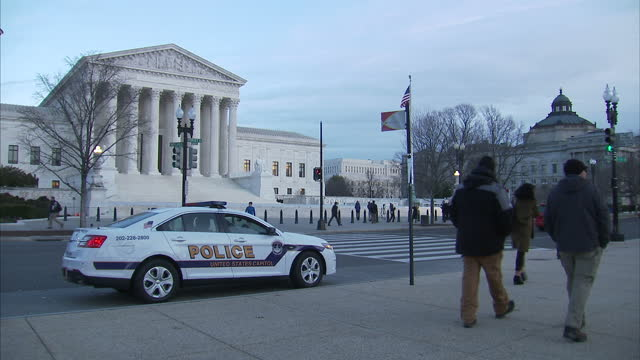 shows exterior shots american flag and police cruiser with emergency lights flashing parked outside the us supreme court building on february 01 2017... - us supreme court building stock videos and b-roll footage