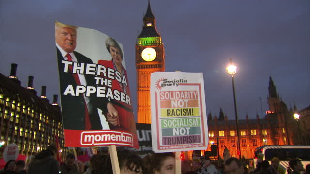 shows exterior shots and aerials protests outside the houses of parliament in london, protesting the state visit of president donald trump as mps... - state visit stock videos & royalty-free footage