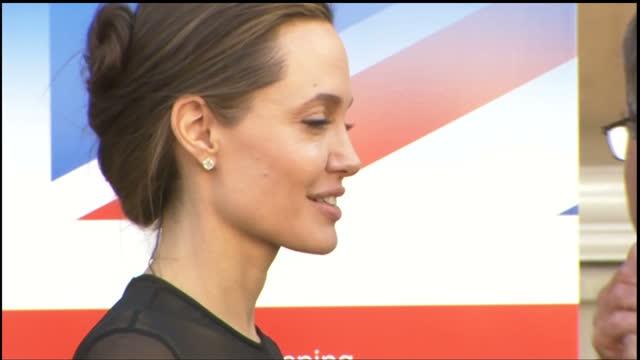 Shows exterior shots Angelina Jolie Pitt standing talking to US Defence Secretary Ash Carter before walking inside building Angelina Jolie joins...