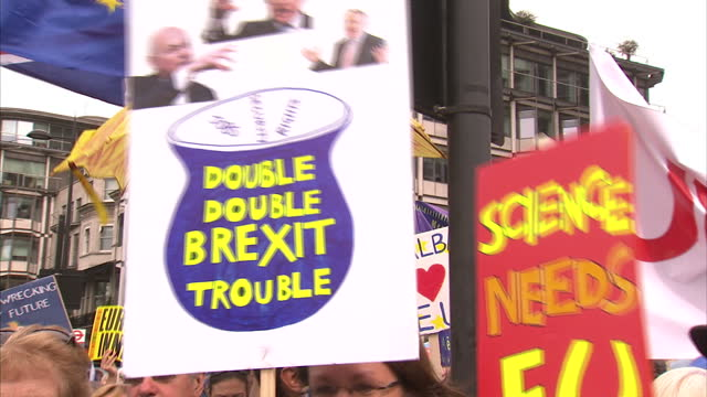 Shows exterior shots AntiBrexit march through streets of London with protesters draped in EU flags Comedian Eddie Izzard walking with protesters and...