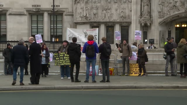 Shows exterior shots antiBREXIT protesters holding signs shouting and chanting outside the Supreme Court in London Far away from Brussels the UK's...