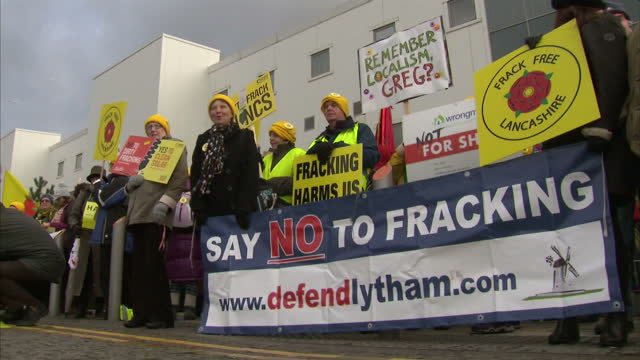 Shows Exterior shots AntiFracking protesters in Blackpool and London including Greenpeace's fake Fracking Rig in Parliament Square in London and...