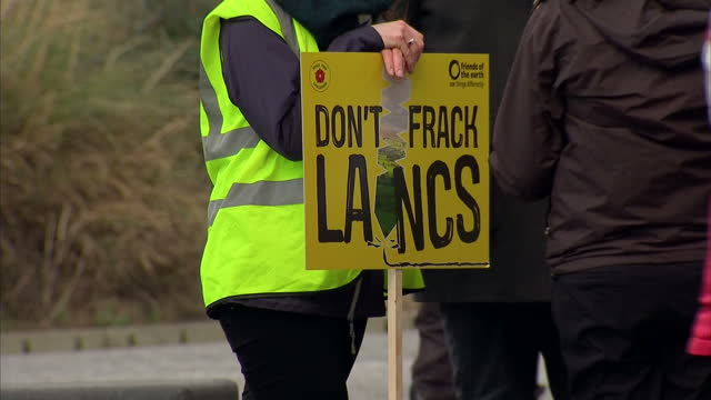 shows exterior shots anti-fracking protesters with posters and banners in blackpool, england, planning inspectors in lancashire are hearing an appeal... - protesta anti fracking video stock e b–roll