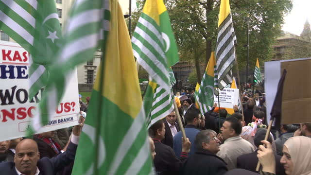 shows exterior shots anti-modi protesters marching down street waving posters and flags including flags of azad jammu and kashmir, a self-governing... - diplomacy stock videos & royalty-free footage
