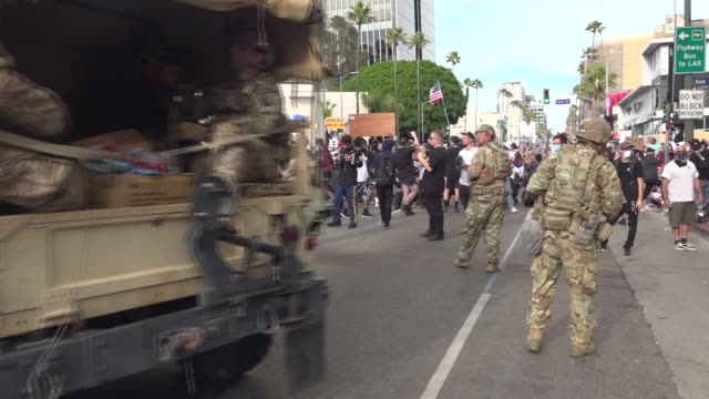 shows exterior shots armed national guard soldiers retreating, getting into vehicles as black lives matter protesters take control of road , at black... - weapon stock videos & royalty-free footage