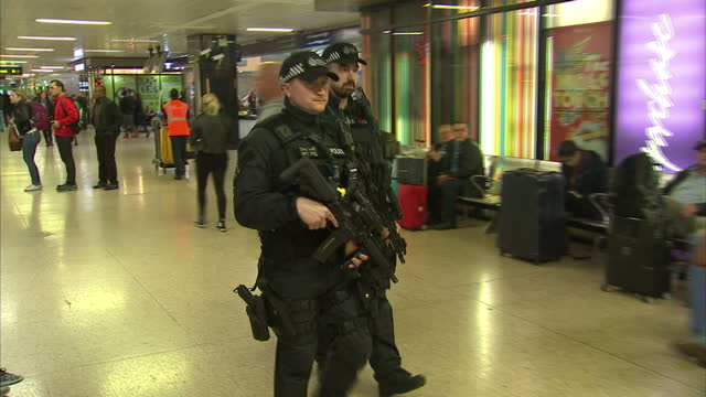 Shows exterior shots armed police officers holding guns patrolling through crowds at Euston Station in London The UKs Threat Level was raised to...