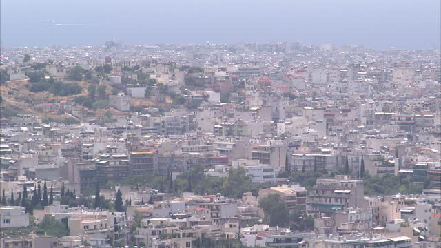 Shows exterior shots Athens city skyline the Parthenon on the Acropolis citadel on June 28 2015 in Athens Greece
