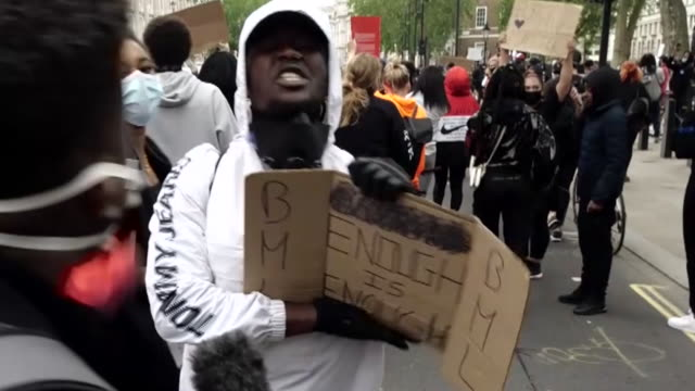 shows exterior shots black lives matter protesters in london, gathered in hyde park, marching through westminster, shouting and chanting, and holding... - protestor stock videos & royalty-free footage